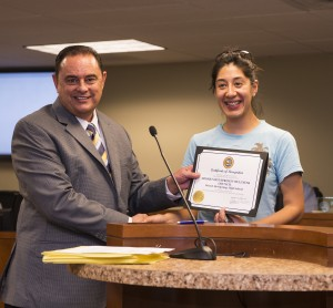 Rocio Jacobo receives certificate of recognition for Family Awareness Day promoting healthy living programs in the city from Mayor Adam Sanchez