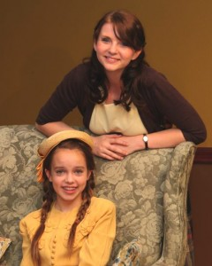 On stage sisters Nora (Elizabeth Schmelling) and Laurie (Madison Tuttle) pose on the set of Brighton Beach Memoirs.