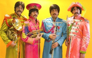 "From left to right: Alex Alazar, Camille Gaede, Branden Figueroa and Alex Moore. Photo taken by Jason Powell. ""Sgtpepper"" shows Nate Bott (""John""), Axel Clarke (""Ringo""), Chris Paul Overall (""Paul"") and Jesse Wilder (""George""). Photo taken by Michelle Fairless."